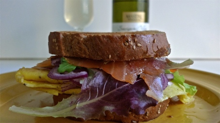 Completed sandwich w wine in background