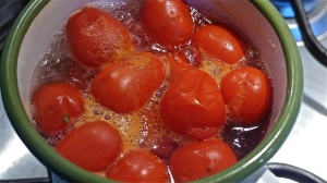 Cherry tomatoes splitting in boiling water