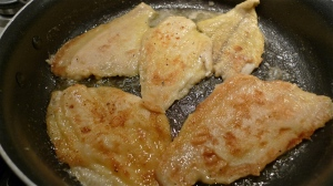 Flounder fillets turned over in skillet