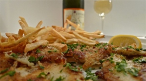 Plated Flounder fillets & fries/chips front bottle of Vespaiola frizzante wine