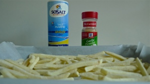 Season French Fries/Chips with Salt and optional Garlic Powder
