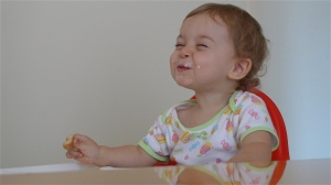 Maddie highchair smile #3 | ©Tom Palladio Images