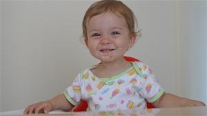 Maddie highchair smile #4 | ©Tom Palladio Images