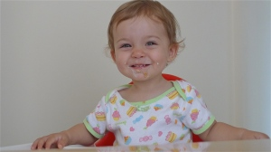 Maddie highchair smile #4 | ©Tom Palladio Images