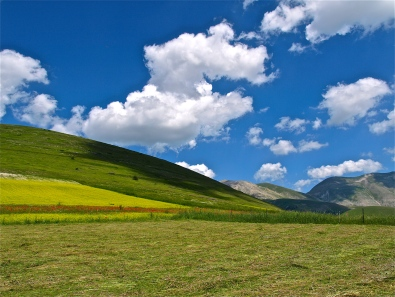 Puffy Whites over Castelluccio | ©Tom Palladio Images