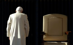 Pope Benedict XVI walking past his chair