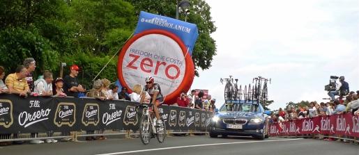 Lone rider leads the team car - Giro d'Italia 2013 | ©Tom Palladio Images