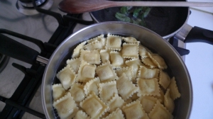 Raviolini into the boiling pot