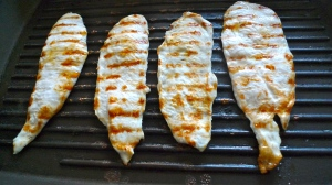 Chicken breasts on the grill | ©Tom Palladio Images