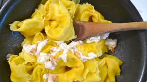 Tortelloni sautéing in the mozzarella and herbal butter